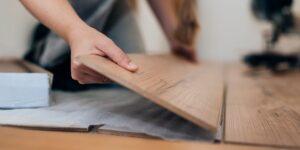woman-installing-laminate-flooring-royalty-free-image-1575498415